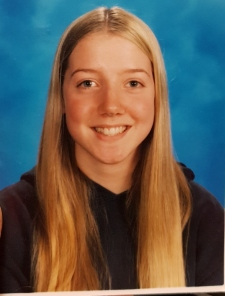 A school picture of fifteen year-old Laura. Her hair is long, blonde, and parted in the middle.