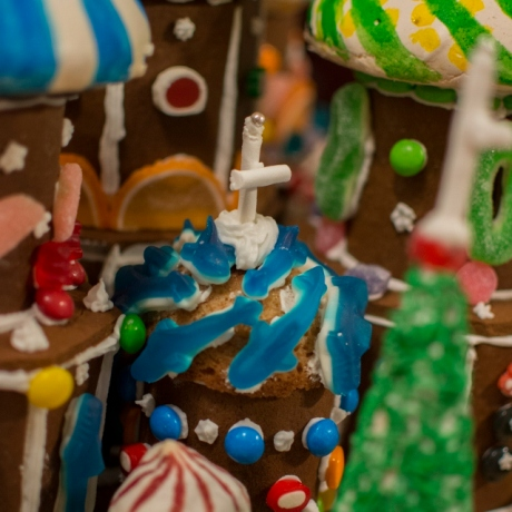A close-up of one of the gingerbread towers with gummi blue sharks iced to the cookie dome.