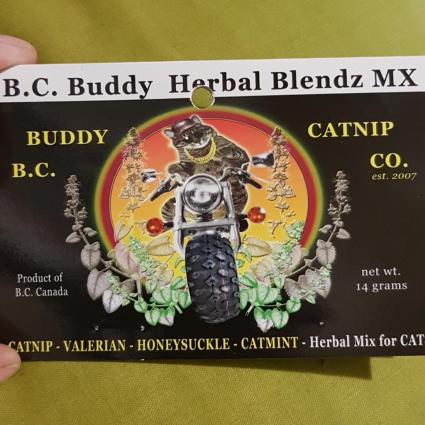 Label featuring a tabby wearing sunglasses, and a gold chain, riding on a motorcycle. The package says BC Buddy Herbal Blendz MX.
