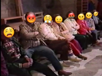 A row of middle-aged white people are seated on a bench. Half of them have their arms crossed. Their faces have been replaced with angry-looking emojis.