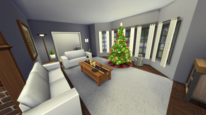 A living room with a rectangle of white carpet in the middle of wood flooring. There are two white couches flanking a long coffee table. In front of the table, before the windows is a Christmas tree.