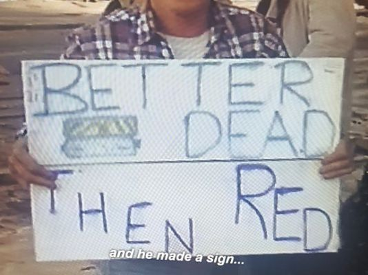 "A homemade sign that says ""Better Dead Then Red""."