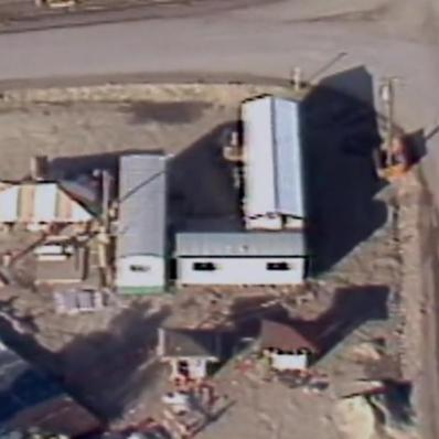 Aerial view of three portable buildings arranged in an u-shape.