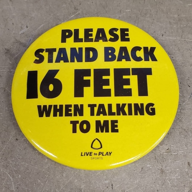 A yellow button reads PLEASE STAND BACK 16 FEET WHEN TALKING TO ME. The 1 has been made out of black electrical tape.