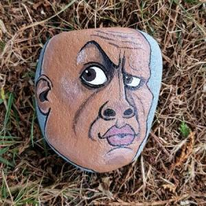 A rock painted to look like The Rock.