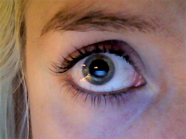A close-up of my right eye with a dilated pupil.