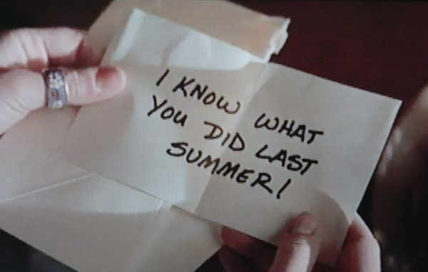 A screen grab from the 1997 film, I Know What You Did Last Summer showing a note with the film's title written in all caps.