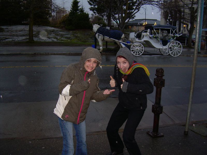 Gator and I show the photographer sarcastic enthusiasm. Our coat hoods are up as it was a rainy day. There's a horse drawn carriage visible in the background.