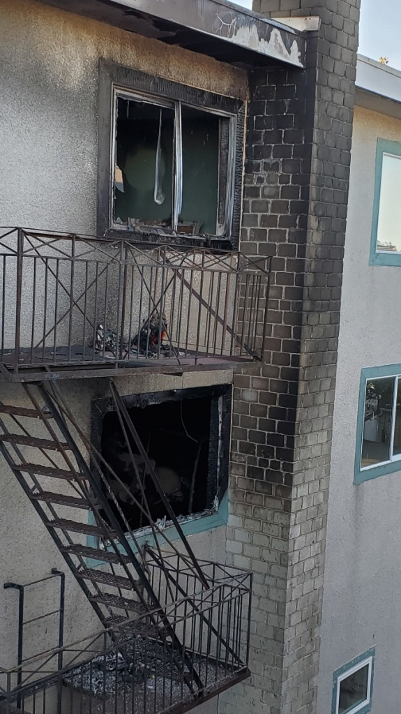 Second and third-storey apartment suites are showing severe fire damage.