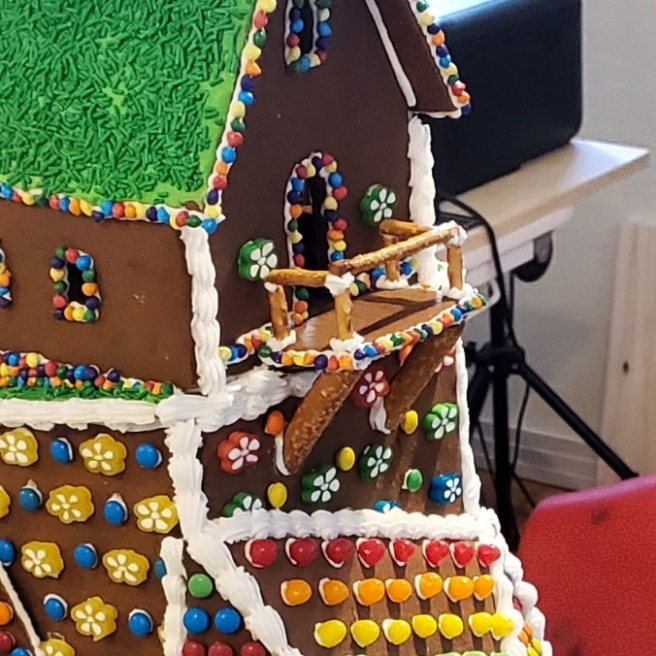 A low-res close-up showing the thick pretzel rods that support the gingerbread house's balcony.