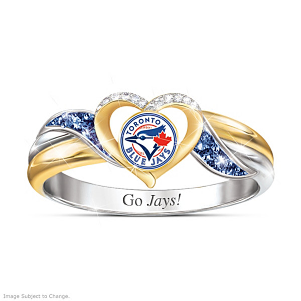 A silver and gold band with blue and white gemstones surrounding a heart that holds the Toronto Blue Jays logo.